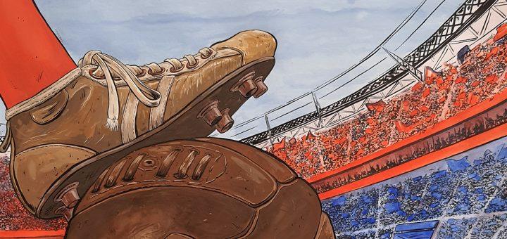 pieds sur un ballon de foot dans le stade de l'OL